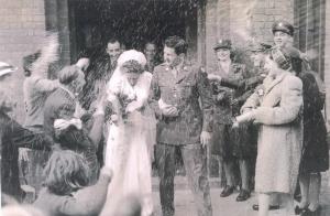 Soldier and his English war bride at wedding.