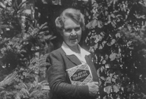 Irma Rombauer holding the 1943 edition of The Joy of Cooking