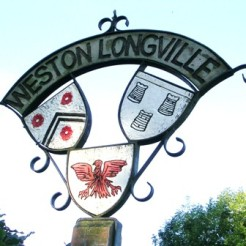In August 1977, during a visit by a group of veterans, an ornamental village sign was dedicated at Weston Longville commemorating the men who lost their lives serving with the 466th BG.