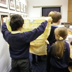 A student examines a silk map